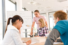 High school students with professor in classroom Royalty Free Stock Photography
