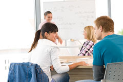 High school students with professor in classroom Royalty Free Stock Photos