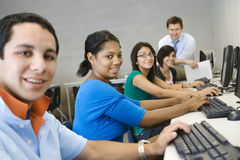 High School Students With Professor In Computer Class. Portrait of high school students with professor in computer class Stock Photo