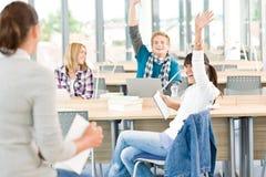 High school students raising hands Royalty Free Stock Photo