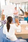 High school students raising hands Stock Images