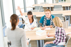 High school students raising hands Stock Images