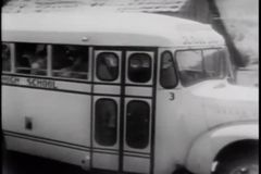 High school students in school bus leaving school in the country stock footage
