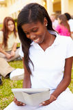 High School Students Studying Outdoors On Campus Stock Photo