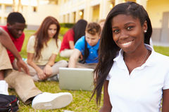 High School Students Studying Outdoors On Campus. Using Laptop Working Together royalty free stock photo