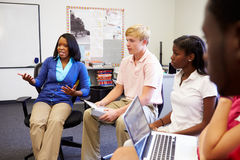 High School Students Taking Part In Group Discussi. On In Classroom Using Laptop Royalty Free Stock Photo