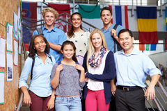 High School Students And Teacher Standing Outside Building Stock Photography