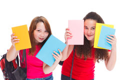 High school students. Two high school students hiding behind books Royalty Free Stock Photos