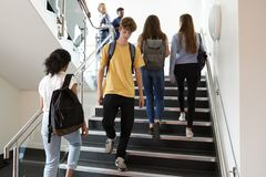 High School Students Walking On Stairs Between Lessons In Busy College Building stock photo