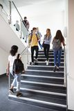 High School Students Walking On Stairs Between Lessons In Busy College Building stock photography