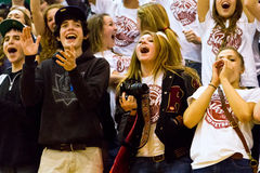 High school supporters. High school students cheering on their basketball team, during a play-off game in Texas (Rouse High School, Austin Stock Image
