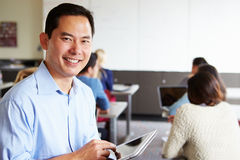High School Teacher With Digital Tablet In Classroom Royalty Free Stock Images