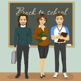 High school teachers standing in front of chalkboard Royalty Free Stock Photo