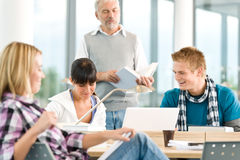 High school - three students with mature professor Stock Photography