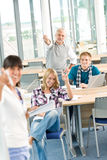 High school - three students with professor Royalty Free Stock Photography