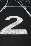 High School Track. View of numbered lanes of outdoor track field Royalty Free Stock Photo