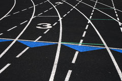 High School Track. View of numbered lanes of outdoor track field Stock Photography