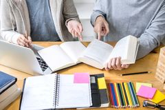 High school tutor or college student group sitting at desk in li. Brary studying and reading, doing homework and lesson practice preparing exam to entrance royalty free stock image