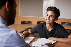 High School Tutor Giving Male Student One To One Tuition At Desk stock images