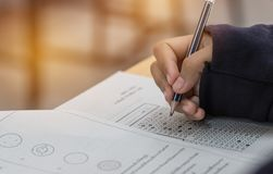 High school or university student hands taking exams, writing ex stock images