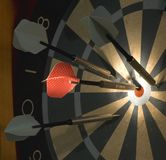 High score. Dart that's hit the bullseye during an indoor game royalty free stock images