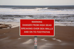 High Seas Warning Sign. On the beach at Scarborough Royalty Free Stock Photo