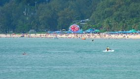 High season in Karon beach in Phuket. People relax on Karon beach. This is one of the most popular beaches among tourists in Phuket stock footage