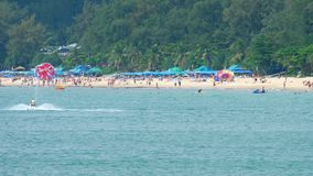 High season in Karon beach in Phuket. People relax on Karon beach. This is one of the most popular beaches among tourists in Phuket stock video footage