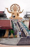 High seated golden Buddha statue Stock Photo