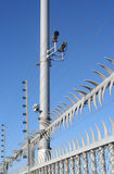 High Security Fence. With video cameras and electric wire Royalty Free Stock Image