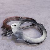 High Security Handcuffs on Concrete Floor Stock Photo
