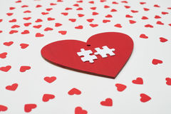 High side angle of card in the form of heart with two white puzz Stock Photo