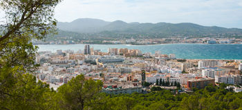 High side view from hills in St Antoni de Portmany, Ibiza, clearing November day. Warm autumn breeze, Balearic Islands, Spain. High, hill side view of St Antoni royalty free stock photos