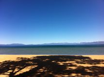 High Sierra Wonderland Lake Tahoe. Shadow on beach of Lake Tahoe California/Nevada stock photography