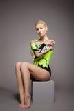 High skill gymnast dancer studio portrait. Posing on grey Royalty Free Stock Photo