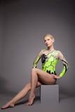 High skill gymnast dancer studio portrait. Posing on grey Royalty Free Stock Images