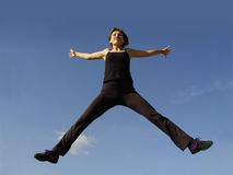 High in the sky. Young woman jumping high in the sky Stock Images