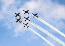 High in the sky. Bees in the sky-image from an air show with 6 planes in the sky Royalty Free Stock Photo