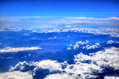High in the sky, puffy white clouds Royalty Free Stock Images