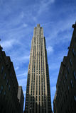 High skycraper. A tall skyscraper under the blue sky in New York Royalty Free Stock Image