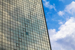 High skyscraper with glass window and blue sky. Royalty Free Stock Images