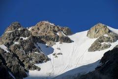 High snow and rocky mountain range Stock Photos