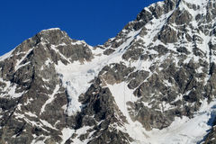 High snow and rocky mountain range Royalty Free Stock Photography