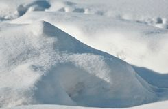 High snowdrift lit by the morning sun royalty free stock photos