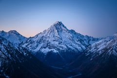 Free High Snowy Mountain In The Evening After Sunset Royalty Free Stock Photos - 142847998