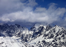 High Snowy Mountains In Clouds At Sunny Day Royalty Free Stock Image