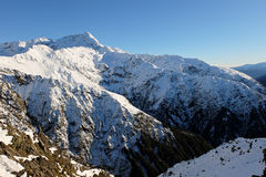 The High and Snowy Peak of Mt Rolleston Viewed from Scotts Track on Avalanche Peak. Royalty Free Stock Photos