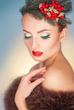 High society woman with wreath on head and healthy skin looking Stock Photo
