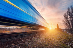 High speed blue passenger train on railroad track in motion Royalty Free Stock Photography