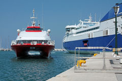 High speed boat arrives at the port Royalty Free Stock Photo